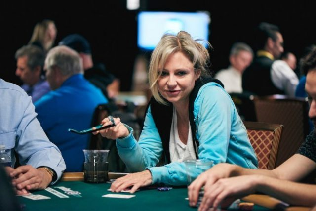 Jennifer Harman playing poker and holding glasses