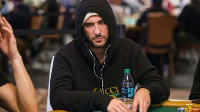 Dario Sammartino playing poker wearing a black hoodie