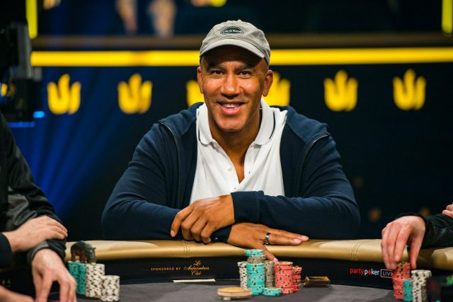 Bill Perkins smiling at the poker table