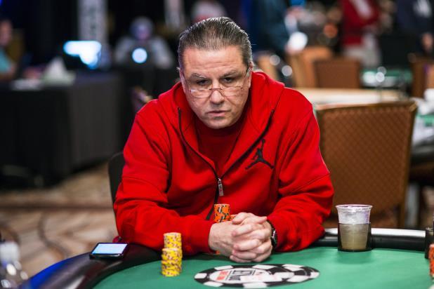 Eli Elezra playing poker wearing a red hoodie