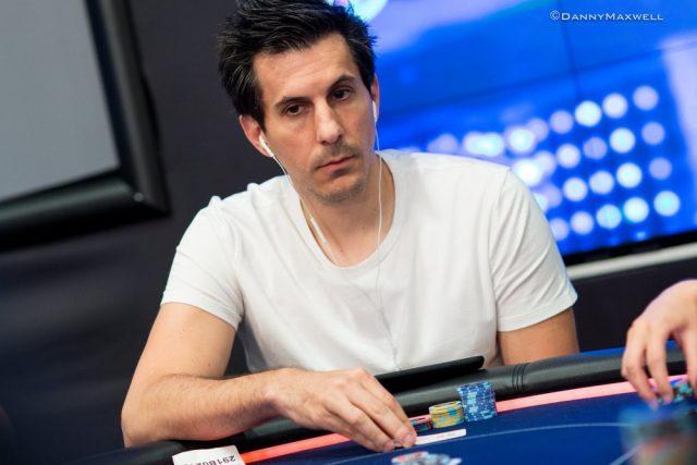 Haralabos Voulgaris playing poker wearing earphones