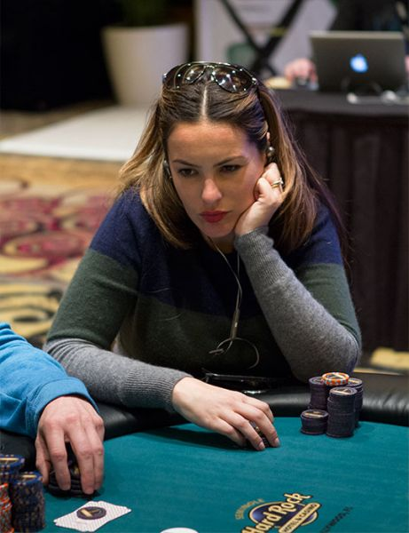Sasha Barrese playing poker  with sunglasses on her head