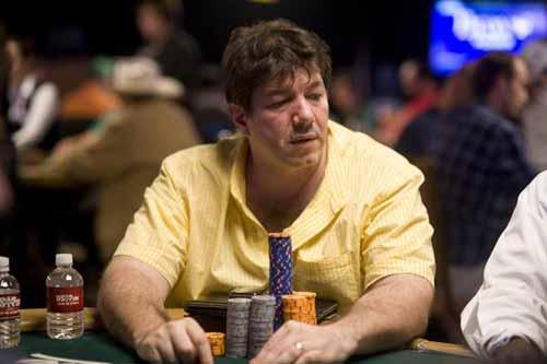 David Benyamine playing poker in a yellow shirt