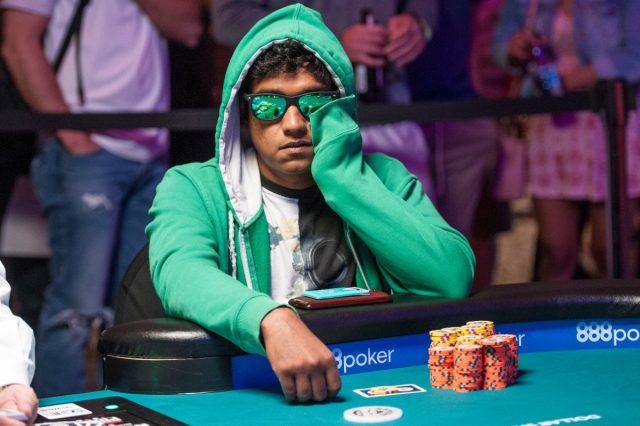 Upeshka De Silva playing poker with a green hoodie