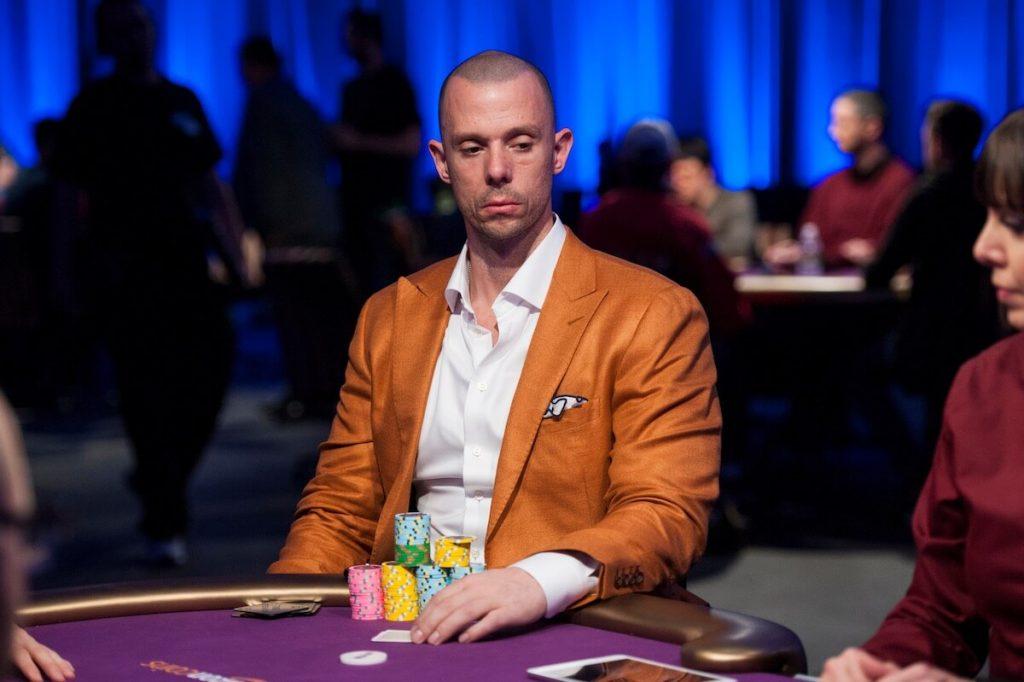 Matt Berkey playing poker in an orange suit